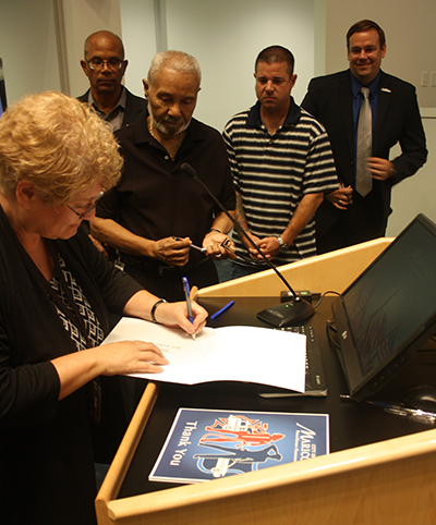 Members of the Maricopa City Council Peggy Chapados, Henry Wade, Marvin Brown, Bridger Kimball and Mayor Christian Price sign cards for the Maricopa Police Department and Maricopa Fired Department to express their gratitude during a July 19 meeting. Photo by Raquel Hendrickson