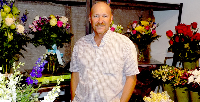 Will Dunn, owner of the Cotton Blossom Flower Shoppe, has built the business into a full wedding-planning company.  Photo by Michelle Chance