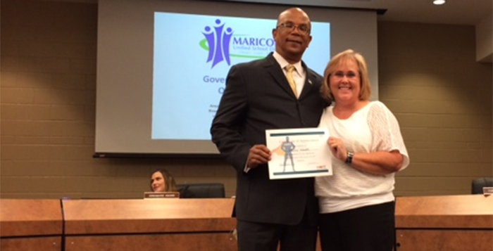 Henry Wade receives a HOPE award from MUSD Governing Board President Patti Coutre. (MUSD photo)