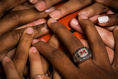 A championship ring highlights a team gathering. Photo by William Lange