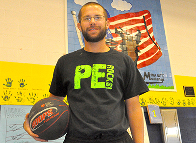 PHOTO Derek Picha teaches physical education at Pima Butte Elementary School and is pursuing a master's degree. Photo by Raquel Hendrickson