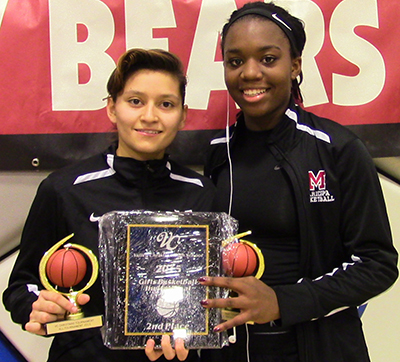Danae Ruiz (left) and Raegene Womack were named to the all-tournament team. Photo by Adam Wolfe