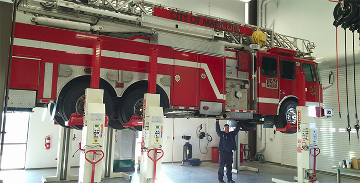 """MFD's Rodney Davenport """"lifting"""" a fire truck in the new facility. City of Maricopa photo"""