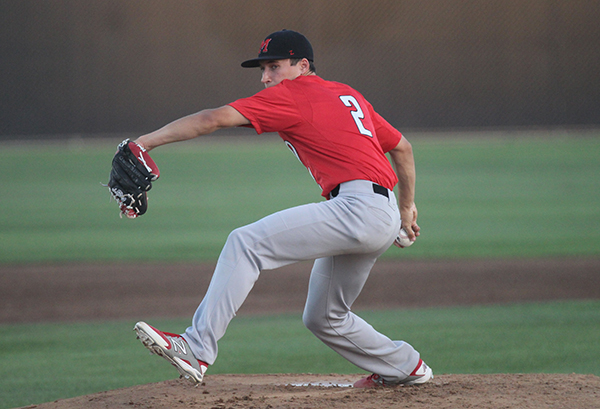 Carter Paine pitches during the Matt Huffman Invitational. Photo by Devin Carson