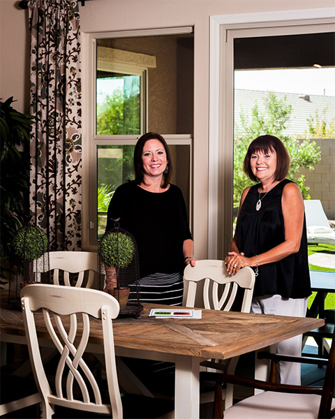 Amy Zinger (left) and Teri Cifalia on the back patio of new model of KB Home, which is one of the homebuilders that recently renewed focus on Maricopa. Photo by Glynn Thrower