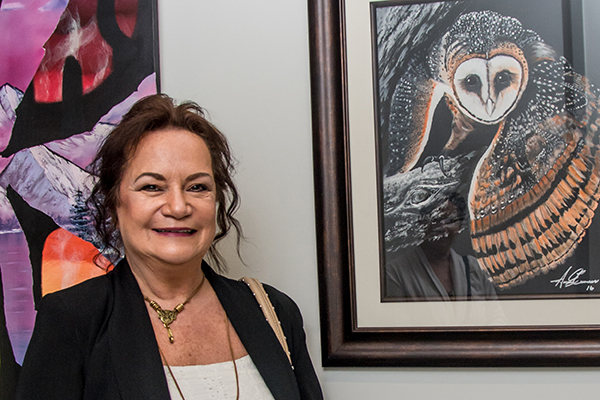 Susan Cameron with her art. Photo by Mason Callejas